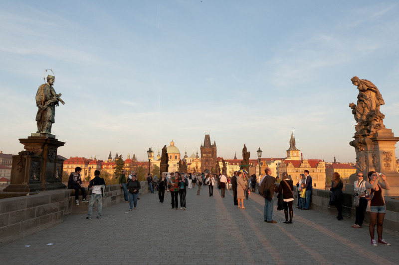 Tourists exploring Charles Bridge in Prague, Czech Republic