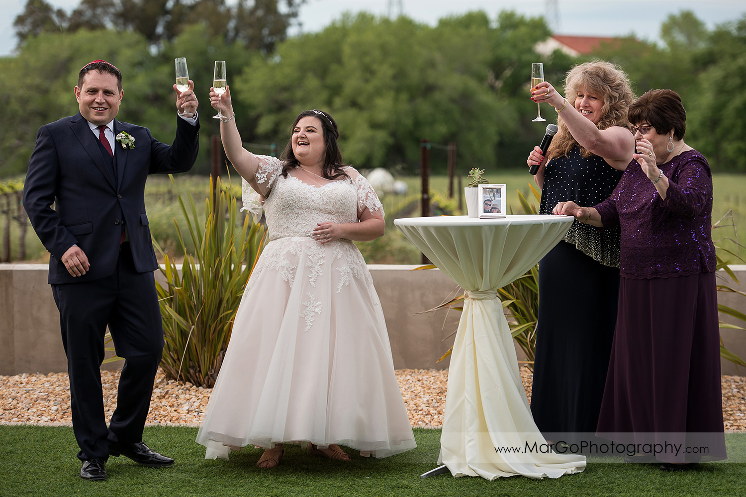 cocktail hour wedding toast at Livermore Garre Vineyard and Winery