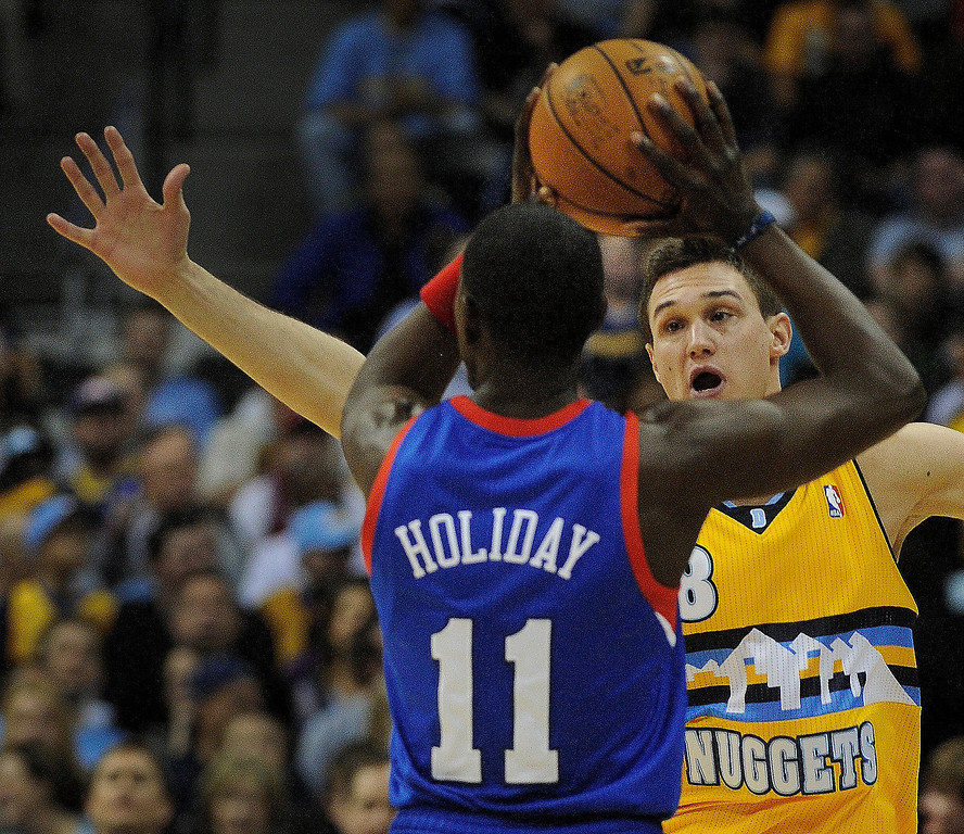 . DENVER, CO. - MARCH 21: Danilo Gallinari (8) of the Denver Nuggets defends Jrue Holiday (11) of the Philadelphia 76ers in the first half. The Denver Nuggets hosted the Philadelphia 76ers Thursday night, March 21, 2013 at the Pepsi Center. (Photo By Karl Gehring/The Denver Post)