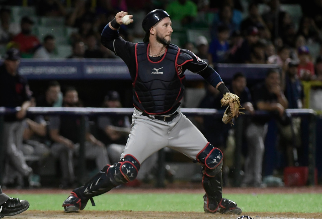. Cleveland Indians catcher Yan Gomes throws to second base in the 15th inning against the Minnesota Twins in a baseball game at Hiram Bithorn Stadium in San Juan, Puerto Rico, Wednesday, April 18, 2018. (AP Photo/Carlos Giusti)