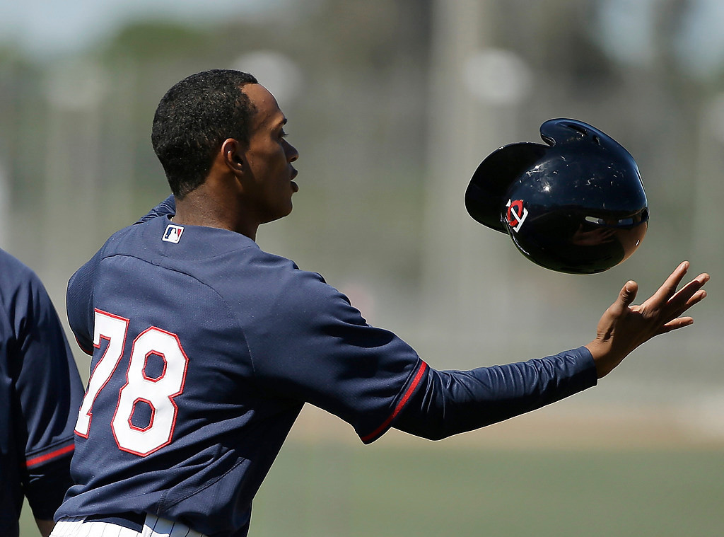 . Minnesota Twins shortstop Jorge Polanco juggles his helmet while working out before an exhibition baseball game against the Boston Red Sox, Saturday, March 1, 2014, in Fort Myers, Fla. (AP Photo/Steven Senne)