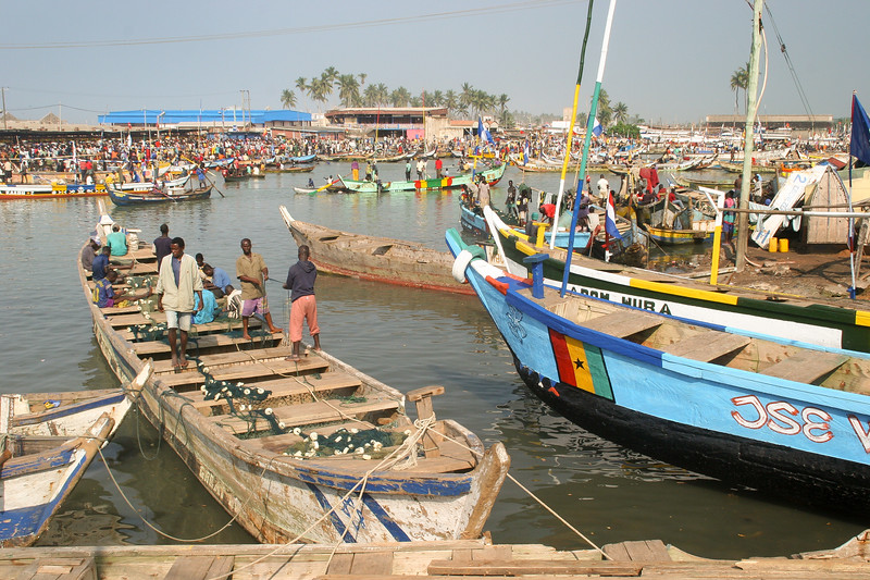A busy fishing community and marketplace surrounds Elmina Castle on the Benya Lagoon in Ghana.