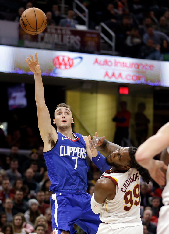 . Los Angeles Clippers\' Sam Dekker releases the ball over Cleveland Cavaliers\' Jae Crowder during the second half of an NBA basketball game, Friday, Nov. 17, 2017, in Cleveland. The Cavaliers won 118-113 in overtime. (AP Photo/Tony Dejak)