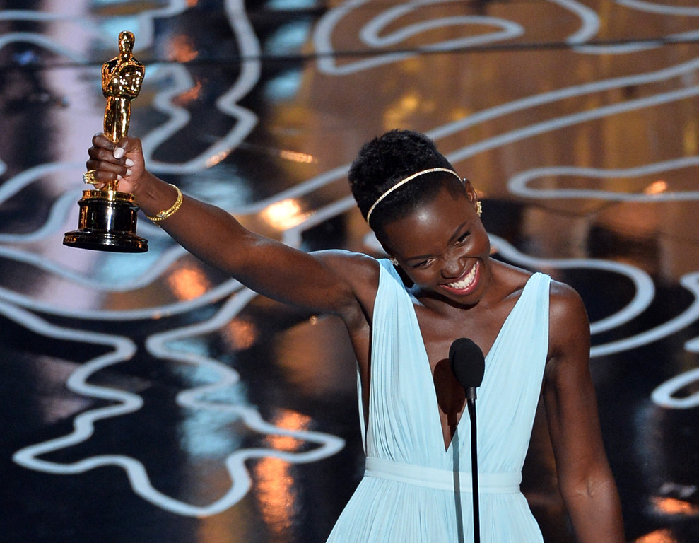 . Actress Lupita Nyong\'o accepts the Best Performance by an Actress in a Supporting Role award for \'12 Years a Slave\' onstage during the Oscars at the Dolby Theatre on March 2, 2014 in Hollywood, California.  (Photo by Kevin Winter/Getty Images)