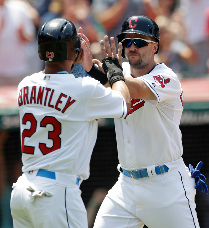 . Cleveland Indians\' Lonnie Chisenhall, right, and Michael Brantley celebrate after both scored in the third inning of a baseball game against the Minnesota Twins, Sunday, June 17, 2018, in Cleveland. (AP Photo/Tony Dejak)