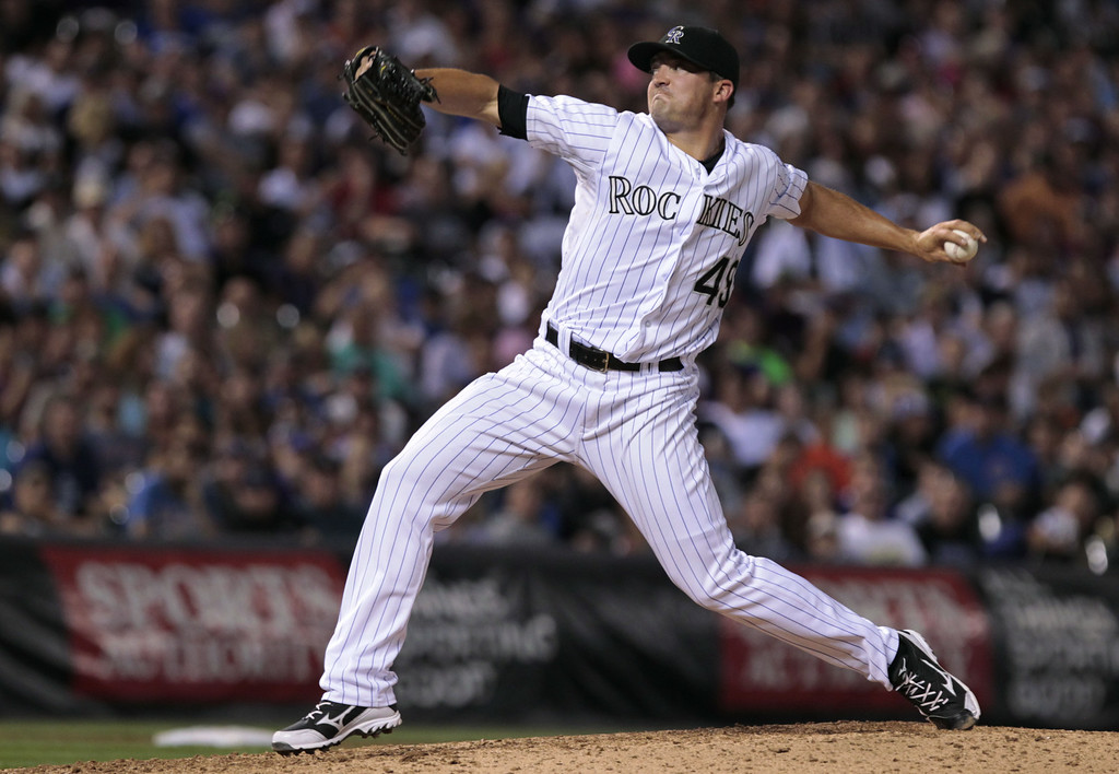 . Colorado Rockies relief pitcher Rex Brothers (49) pitches in the seventh inning of a baseball game against the Chicago Cubs in Denver on Tuesday, Aug. 5, 2014. Rockies pitchers walked in two runs and allowed an RBI during the inning.(AP Photo/Joe Mahoney)