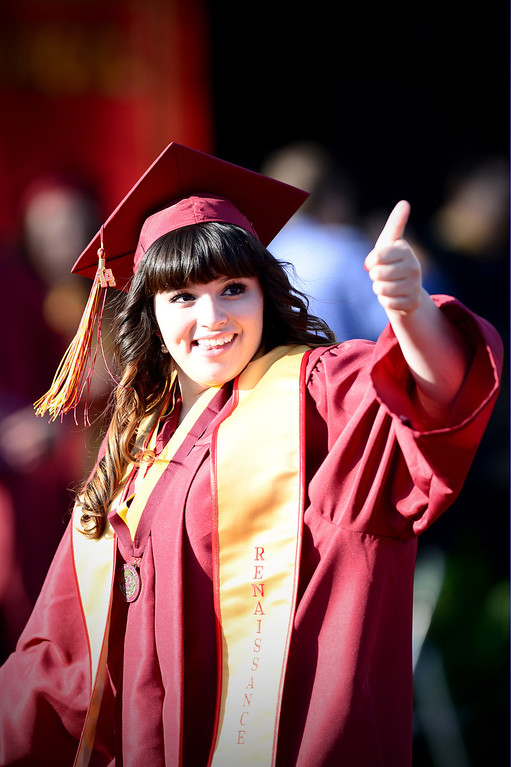 . Serena Alba, a district scholar, celebrates after receiving her diploma during Wilson High School\'s forty-seventh commencement ceremony Tuesday evening, May 20, 2014 at the Hacienda Heights school. (Photo by Sarah Reingewirtz/Pasadena Star-News)