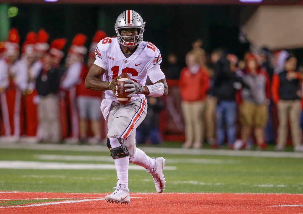 . Ohio State quarterback J.T. Barrett (16) carries the ball during the first half of an NCAA college football game against Nebraska in Lincoln, Neb., Saturday, Oct. 14, 2017. Barrett passed for five touchdowns and ran for two others as Ohio State won 56-14. (AP Photo/Nati Harnik)