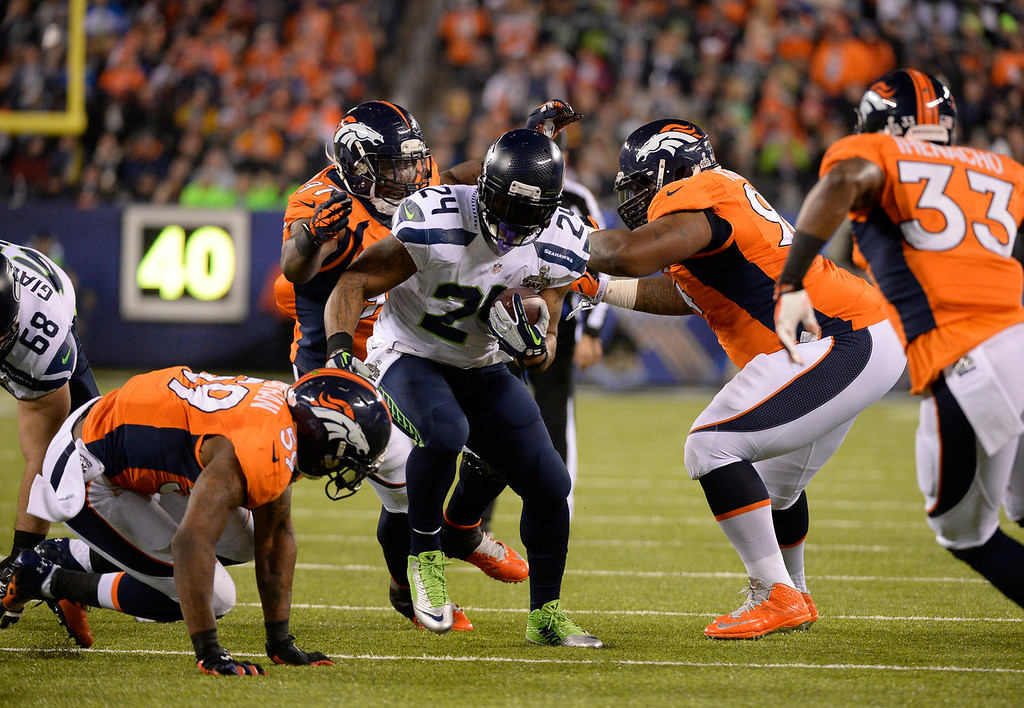 . Seattle Seahawks running back Marshawn Lynch (24) runs during the second quarter. The Denver Broncos vs the Seattle Seahawks in Super Bowl XLVIII at MetLife Stadium in East Rutherford, New Jersey Sunday, February 2, 2014. (Photo by John Leyba/The Denver Post)