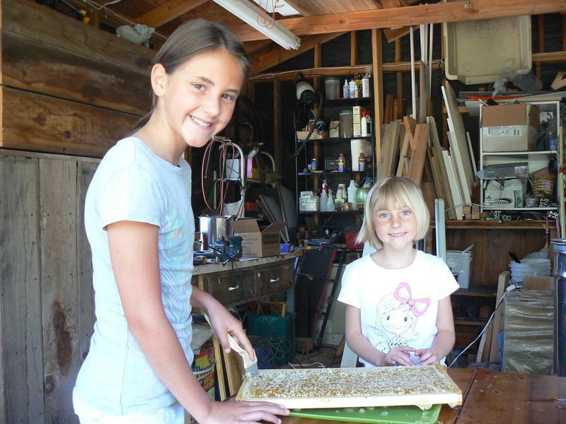 Ronja and Amaja helping spin the honey