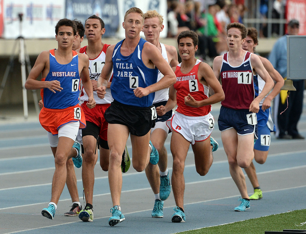 . Westlake\'s Mikey Giguere, left, competes in the division 2 3200 meter run during the CIF Southern Section track and final Championships at Cerritos College in Norwalk, Calif., Saturday, May 24, 2014.   (Keith Birmingham/Pasadena Star-News)