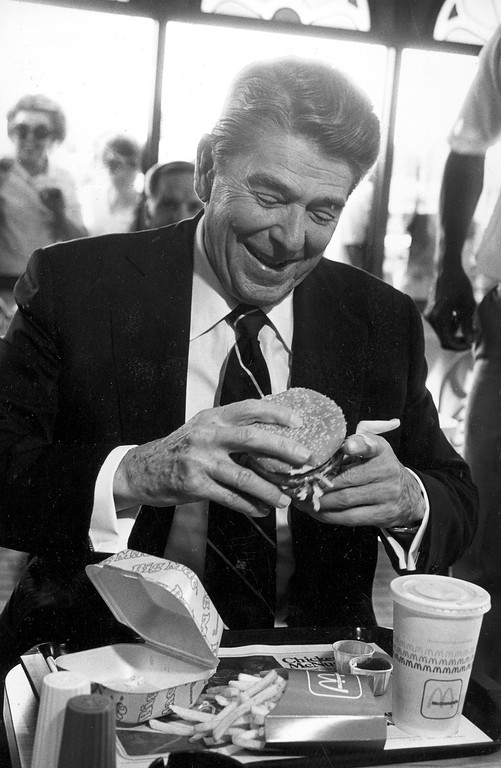 . U.S. President Ronald Reagan eats at a McDonald\'s restaurant after addressing students at the University of Alabama in Tuscaloosa, Ala., on Oct. 16, 1984.  The president ordered a Big Mac, large fries and a sweetened iced-tea.  (AP Photo/Lana Harris)
