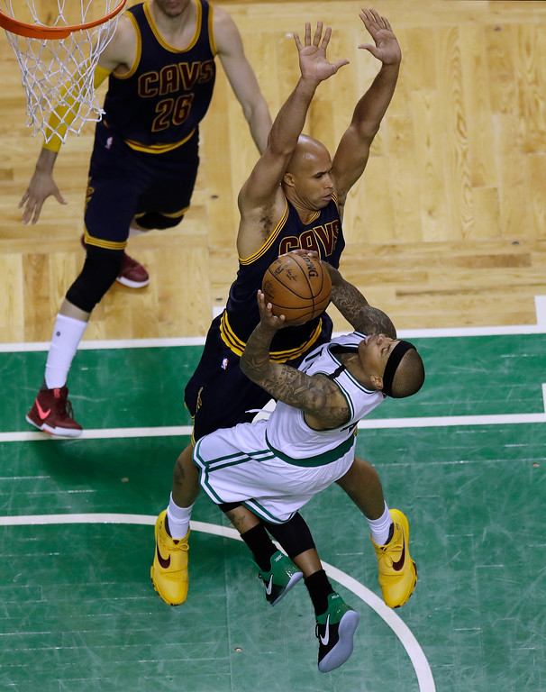 . Boston Celtics guard Isaiah Thomas, front, drives into the defense of Cleveland Cavaliers forward Richard Jefferson during the fourth quarter of Game 1 of the NBA basketball Eastern Conference finals, Wednesday, May 17, 2017, in Boston. (AP Photo/Charles Krupa)