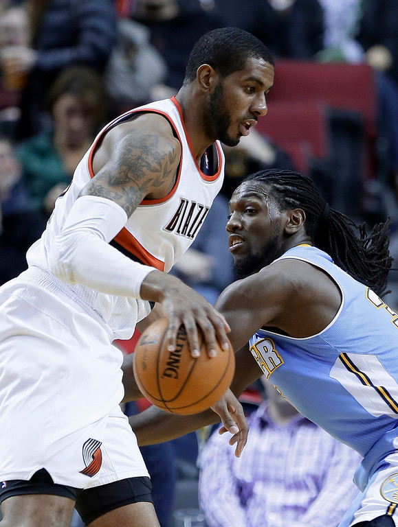 . Portland Trail Blazers forward LaMarcus Aldridge, left, drives on Denver Nuggets forward Kenneth Faried during the first half of an NBA basketball game in Portland, Ore., Thursday, Jan. 23, 2014. (AP Photo/Don Ryan)