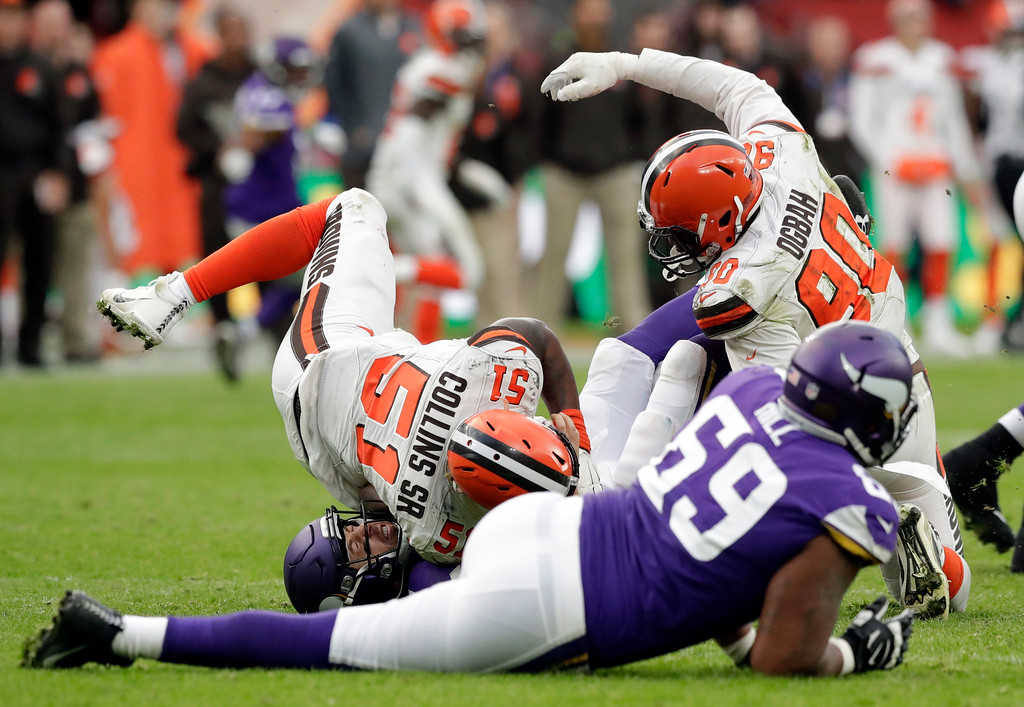 . Minnesota Vikings quarterback Case Keenum (7), bottom left, grimaces after he tackled during the second half of an NFL football game against Cleveland Browns at Twickenham Stadium in London, Sunday Oct. 29, 2017. (AP Photo/Matt Dunham)