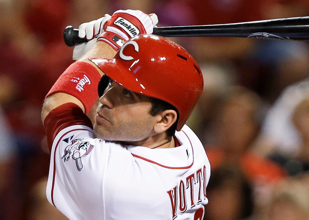 . Cincinnati Reds\' Joey Votto watches his two-run home run off Los Angeles Dodgers relief pitcher J.P. Howell in the fifth inning of a baseball game, Friday, Sept. 6, 2013, in Cincinnati. (AP Photo/Al Behrman)