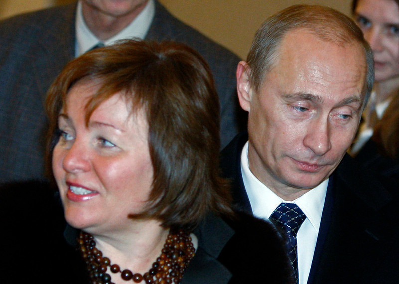 . Russian President Vladimir Putin and his wife Lyudmila walk at a polling station during a parliamentary election in Moscow on Dec. 2, 2007. Russian President Vladimir Putin and his wife Lyudmila have announced they are divorcing.  Married just a few weeks short of 30 years, the Putins announced the decision on state television after attending a ballet performance Thursday evening in the Kremlin. (AP Photo/Misha Japaridze, file)