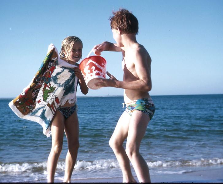 1974-1 (28) David 10 yrs 1 mth with bucket wetting Susan 8 yrs 6 mths @ Cowes.jpg