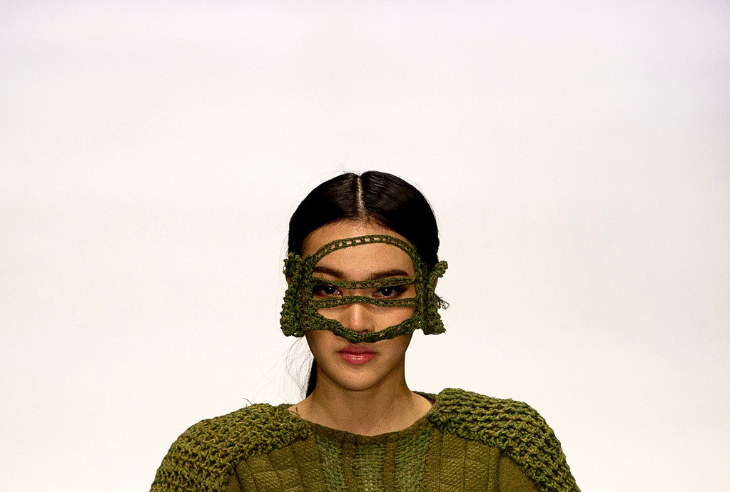 . A Chinese model presents a creation on stage by Chinese designer Wang Xiaoyu during the Huafu Cup fashion design contest at China Fashion Week in Beijing Monday, Oct. 28, 2013. (AP Photo/Andy Wong)