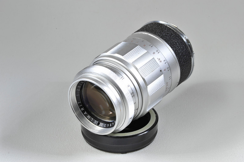 90mm f2.8 Elmarit with 90mm LTM-M adpapter. Condition mint minus. No hood. caps included. This lens is LTM. I think the production run in this lens was 2000 pieces from 1959 to 1963. Made for use with the IIIG camera.