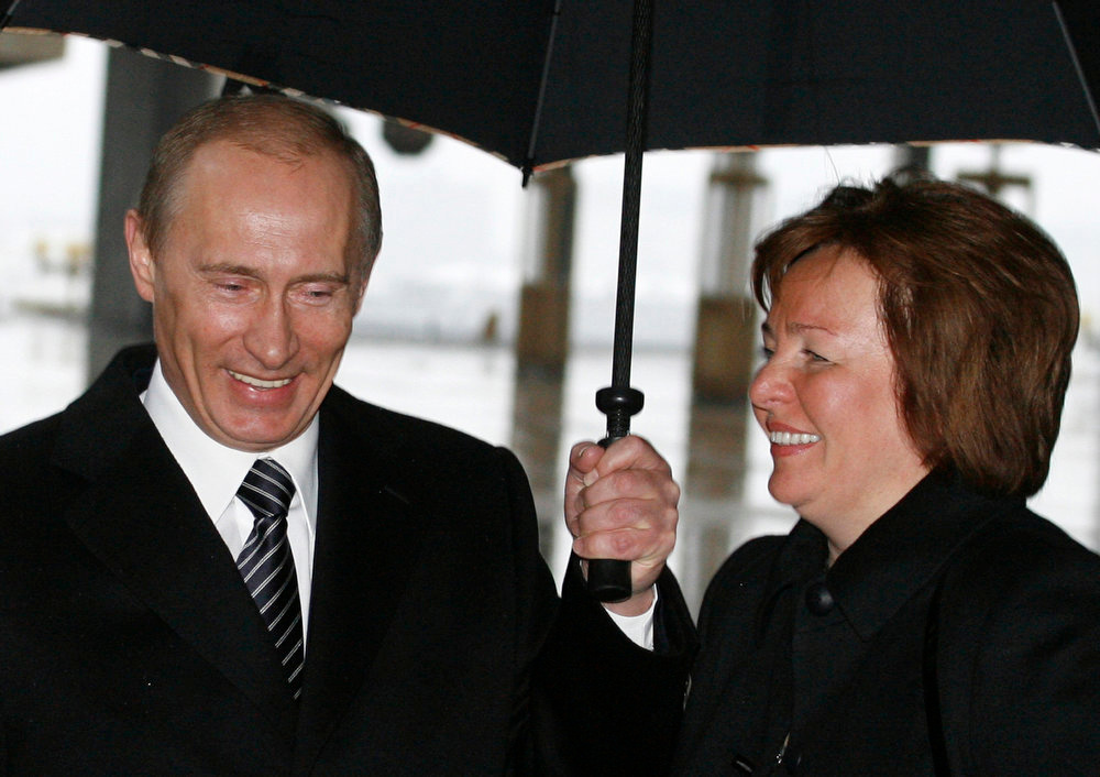 . Russia\'s President Vladimir Putin and his wife, Lyudmila, walk to a polling station in Moscow in this March 2, 2008 file photo. Putin and his wife, Lyudmila, said on state television on Thursday that they had separated and their marriage was over after 30 years. REUTERS/Pool/Files
