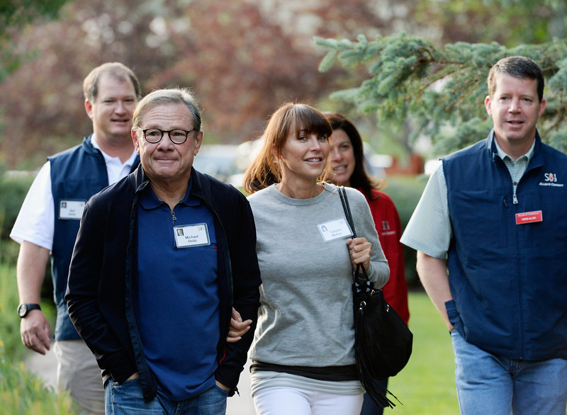 . Entertainment executive Michael Ovitz (L) and Tamara Mellon (C) former Chief Creative Officer and co-founder of Jimmy Choo, arrive for the Allen & Co. annual conference at the Sun Valley Resort on July 10, 2013 in Sun Valley, Idaho. The resort is hosting corporate leaders for the 31st annual Allen & Co. media and technology conference where some of the wealthiest and most powerful executives in media, finance, politics and tech gather for weeklong meetings. Past attendees included Warren Buffett, Bill Gates and Mark Zuckerberg.  (Photo by Kevork Djansezian/Getty Images)