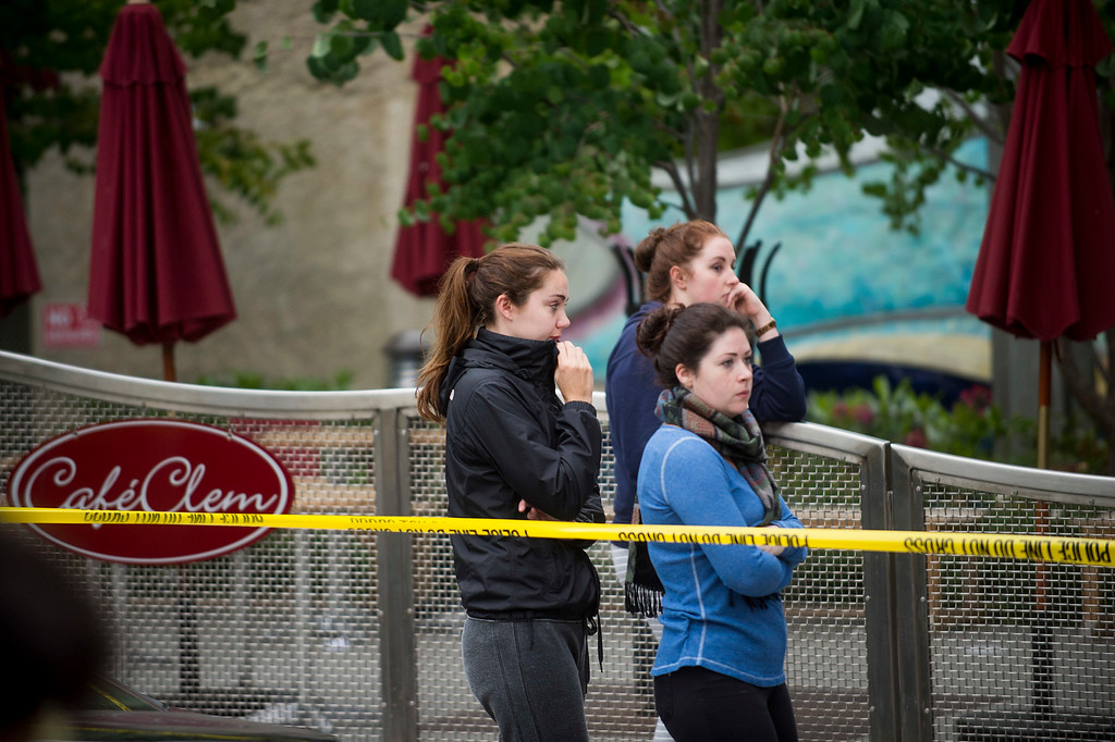. People gather at the scene of a balcony collapse in Berkeley, Calif. on Tuesday, June 16, 2015.  Berkeley police say several people are dead and others injured after a balcony fell shortly before 1 a.m., near the University of California, Berkeley. (AP Photo/Noah Berger)