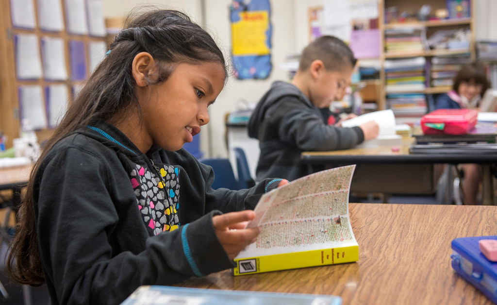 . Longfellow Elementary School third-grader Mariah Precious Madrid, 8, looks through her new dictionary donated by Whittier Elks Lodge #1258  at the Whittier campus April 8, 2013.  (SGVN/Staff photo by Leo Jarzomb)