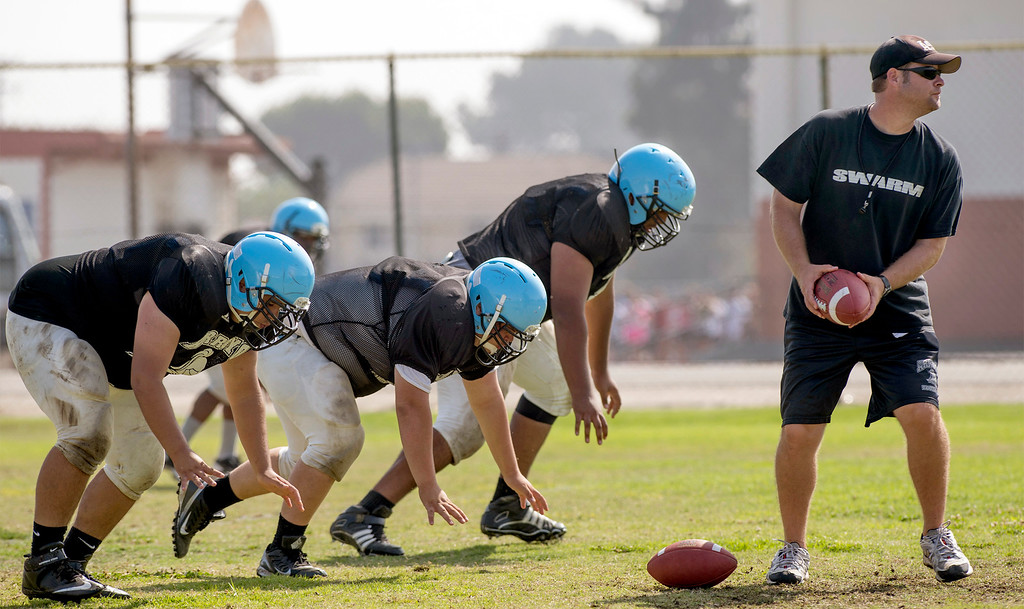 . Arroyo High football offensive coordinator Chris McMillan leads a conditioning drill during preseason practice at the El Monte campus August 14, 2013.   (SGVN/Staff photo by Leo Jarzomb)