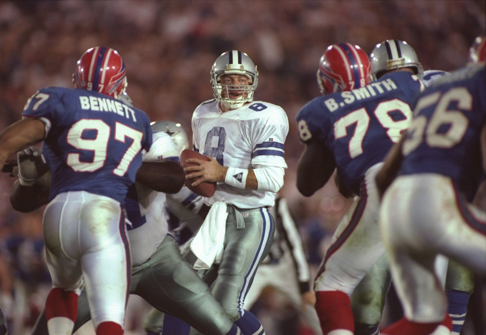 Description of . Quarterback Troy Aikman #8 of the Dallas Cowboys looks to pass against the Buffalo Bills during Super Bowl XXVII at the Rose Bowl in Pasadena, California on January 31, 1993. The Cowboys won the game, 52-17.