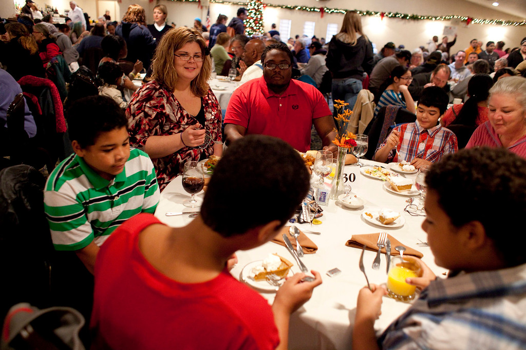 . Kerrie Wagner and Anthony Taylor (center) eat with Wagner\'s sons, Jeremiah, Kaleb, and Zac, at the Matterhorn Restaurant early Thanksgiving afternoon on Thursday, Nov. 28, 2013. The restaurant, along with Salvation Army, served food from 11 a.m. to 2 p.m., and with hundreds attending, it was the largest meal in Elkhart for the day. (AP Photo/The Truth, Jon Garcia)