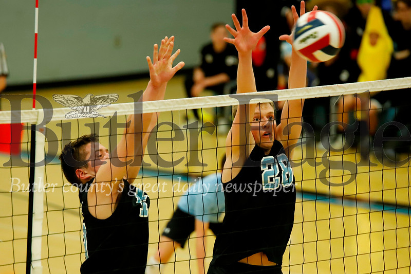 Jacob Smeltzer (#28) and Caleb Daweson go for a block in Seneca's win over Baldwin. Seb Foltz/Butler Eagle