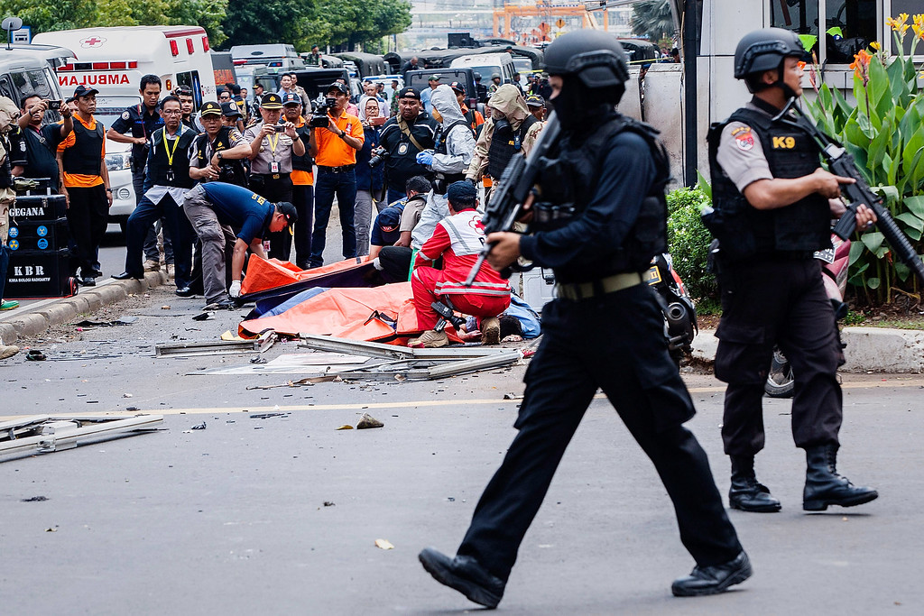 . Indonesian policemen stand guard in front of Sarinah shopping mall after a series of blasts hit the Indonesia capital Jakarta on January 14, 2016 in Jakarta, Indonesia. Reports of explosions and gunshots in the centre of the Indonesian capital, including outside the United Nations building and in the front of the Sarinah shopping mall, an area with many luxury hotels, embassies and offices.  (Photo by Oscar Siagian/Getty Images)