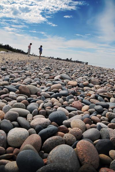 Karen and Lexi explore the beach.