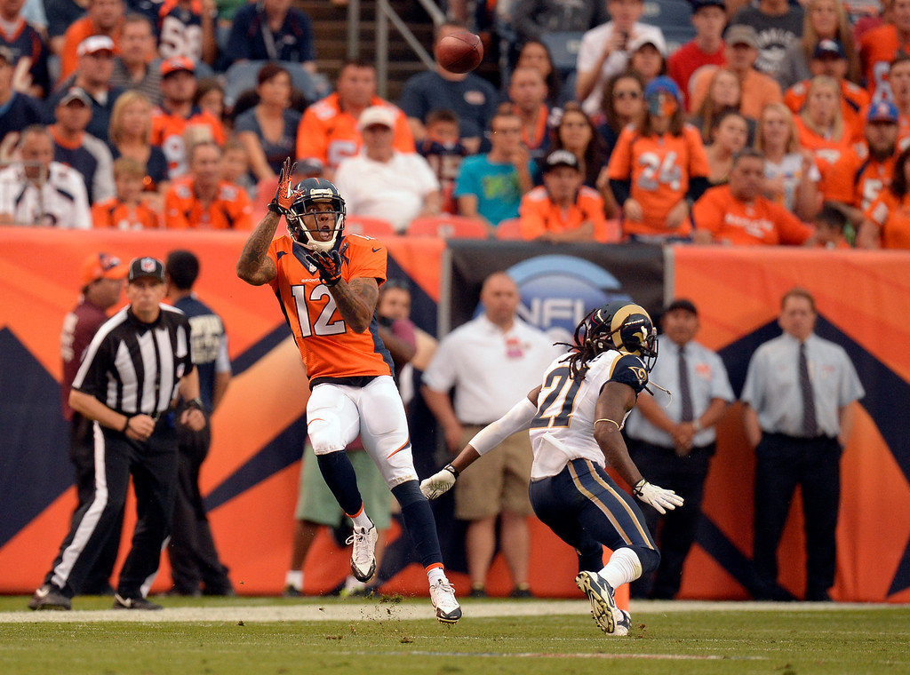 . DENVER, CO. - AUGUST 17: Denver Broncos wide receiver Andre Caldwell (12) catches a pass over St. Louis Rams cornerback Janoris Jenkins (21) during the second quarter August 24, 2013 at Sports Authority Field at Mile High. (Photo By John Leyba/The Denver Post)