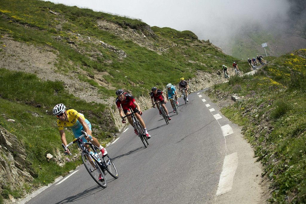 . Italy\'s Vincenzo Nibali wearing the overall leader\'s yellow jersey rides in the pack during the 145.5 km eighteenth stage of the 101st edition of the Tour de France cycling race on July 24, 2014 between Pau and Hautacam, southwestern France.  AFP PHOTO / LIONEL BONAVENTURE/AFP/Getty Images