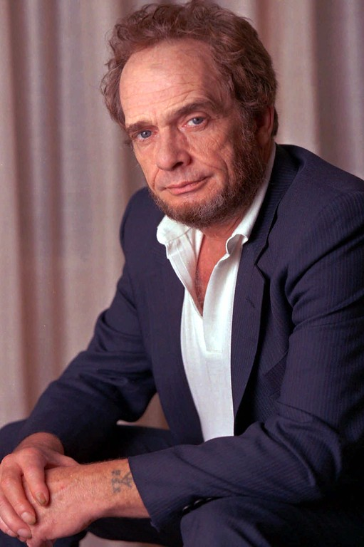 . Country singer Merle Haggard is shown in this September 1989 photo. Haggard was the headliner at the Red River Music Festival in Wichita Falls, Texas on Sunday, Aug. 30, 1998,  but a gum infection forced organizers to postpone the show. (AP Photo/Wyatt Counts)