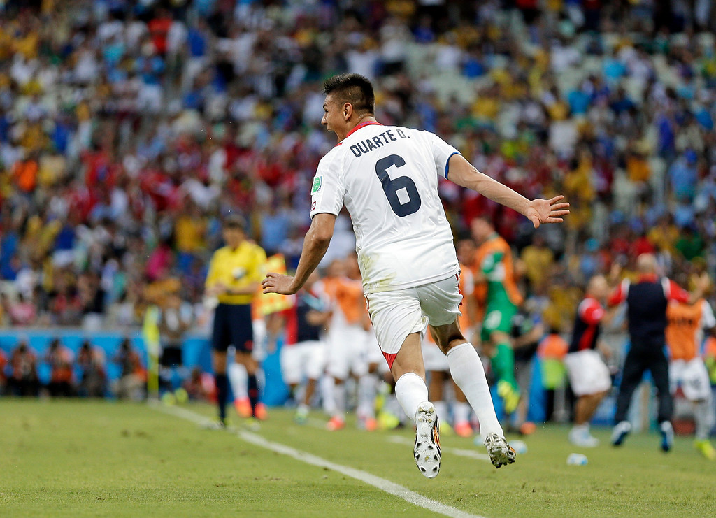 . Costa Rica\'s Oscar Duarte celebrates after scoring his side\'s second goal during the group D World Cup soccer match between Uruguay and Costa Rica at the Arena Castelao in Fortaleza, Brazil, Saturday, June 14, 2014.  (AP Photo/Natacha Pisarenko)