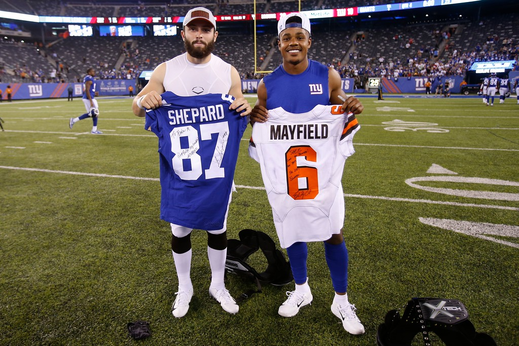 . New York Giants wide receiver Sterling Shepard, right, poses for photographs with Cleveland Browns\' Baker Mayfield, left, after a preseason NFL football game Thursday, Aug. 9, 2018, in East Rutherford, N.J. The Browns won 20-10. (AP Photo/Adam Hunger)