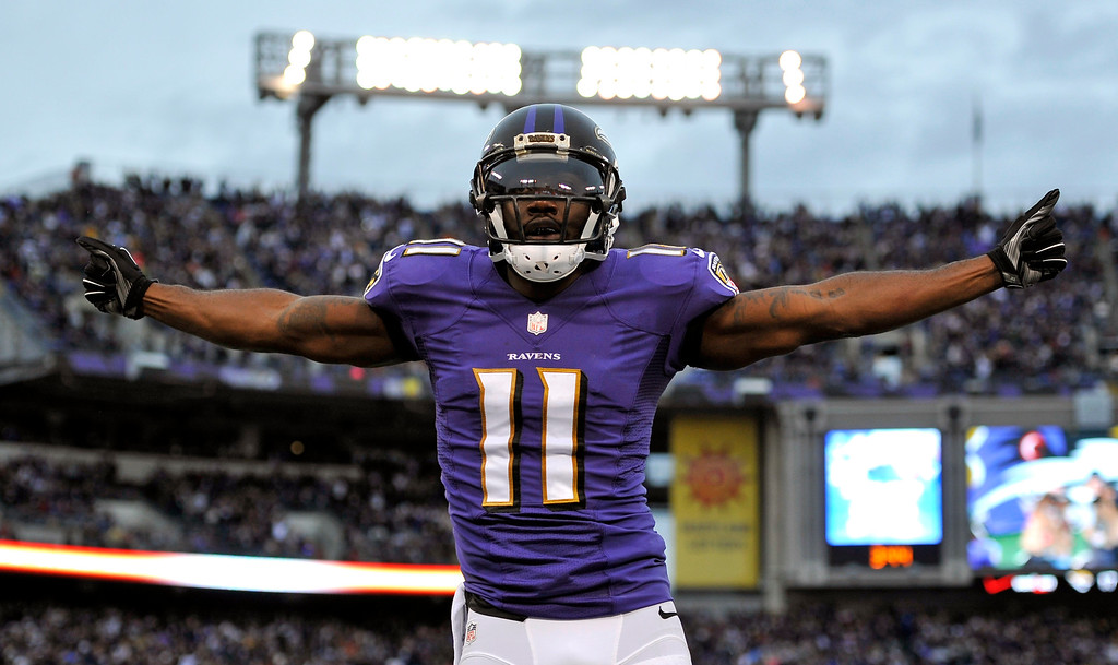. Baltimore Ravens wide receiver Kamar Aiken celebrates after scoring a touchdown in the second half of an NFL football game against the Cleveland Browns, Sunday, Dec. 28, 2014, in Baltimore. Baltimore won 20-10. (AP Photo/Gail Burton)