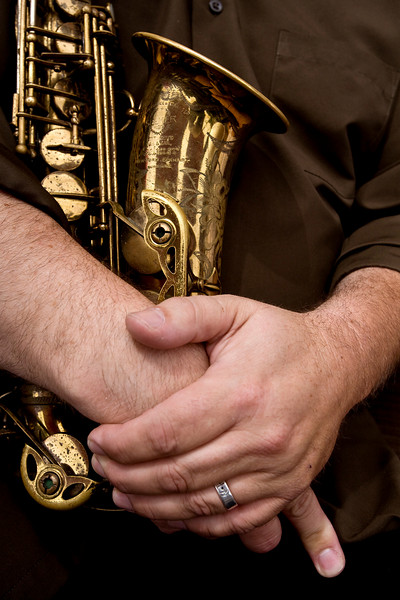 the hands of a jazz saxophonist