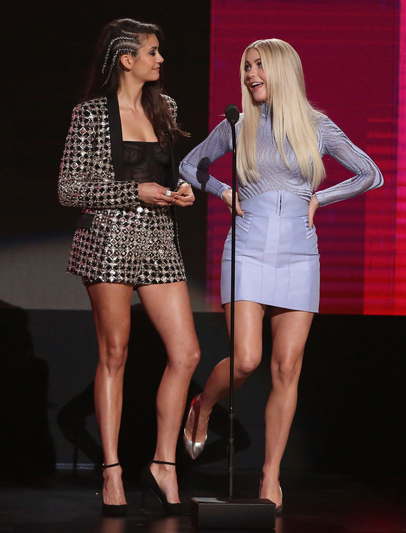 . Nina Dobrev, left, and Julianne Hough present the award for favorite album rap/hip-hop at the American Music Awards at the Microsoft Theater on Sunday, Nov. 20, 2016, in Los Angeles. (Photo by Matt Sayles/Invision/AP)