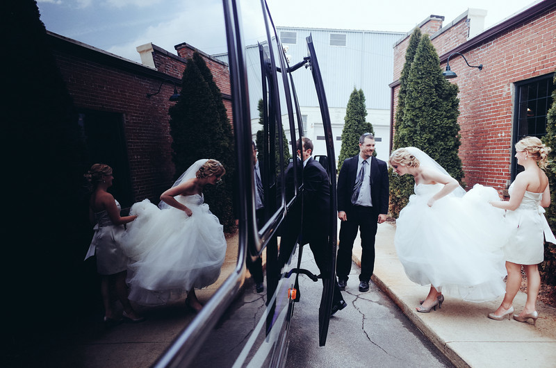 Preparations, pre-ceremony, reveal, bridal party and family formals photography at Emmanuel Lutheran Church and Prairie St. Brewhouse in Rockford, IL before an early Spring wedding. Wedding photographer – Ryan Davis Photography – Rockford, Illinois.