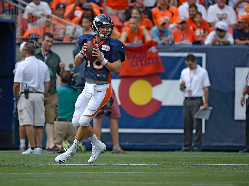 . Denver Broncos quarterback Peyton Manning (18) runs through drills on day four of the Denver Broncos 2014 training camp July 27, 2014 at Sports Authority Field at Mile High. (Photo by John Leyba/The Denver Post)