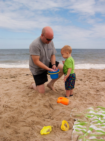 Ethan has a hard time keeping the sand off his hands...and consequently has a hard time keeping it out of his mouth.