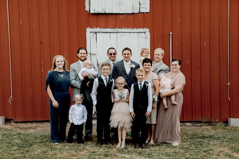 Groom w/ Family + Bridesmaids