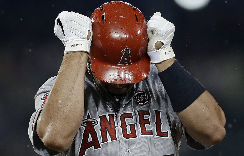 ". <p>4. ALBERT PUJOLS <p>Season-ending foot injury won�t hinder his ability to walk down to bank to cash really, really bloated paychecks. (unranked) <p><b><a href=\'http://www.usatoday.com/story/sports/mlb/angels/2013/08/19/albert-pujols-out-for-season-partially-torn-plantar-fascia-left-foot/2674771/\' target=""_blank\""> HUH?</a></b> <p>    (AP Photo/Paul Sancya, File)"