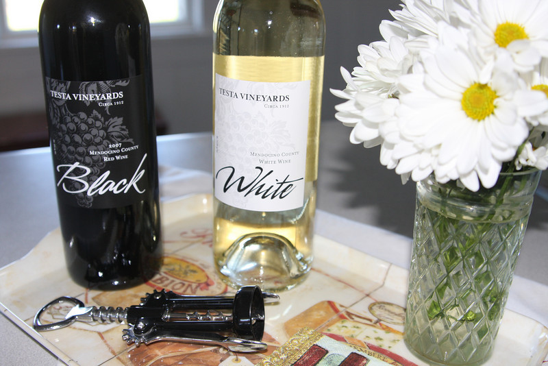 The Vineyard features an historic old home that is available for rental. The Testa signature wines have their proper place on the kitchen table.