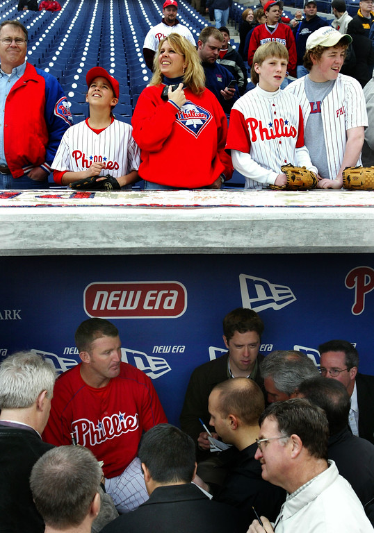 . Philadelphia Phillies Jim Thome is interviewed in the dugout as fans view the new stadium for the first time Saturday, April 3, 2004 in Philadelphia. The Phillies play the Cleveland Indians in an exhibition for the first game their new stadium. (AP Photo/Rusty Kennedy)