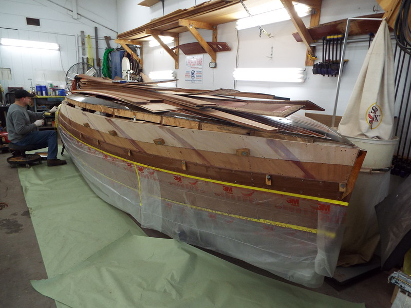 Epoxy being applied to the hull for the fourth starboard plank.